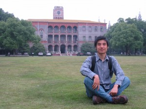 Chinese man, sitting on the campus of Suzhou University